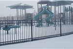 Snow on playground at Centennial Park